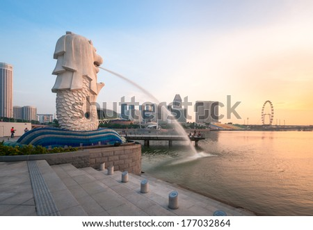 SINGAPORE-Jan, 18 - The Merlion fountain and Marina Bay with sunrise morning Jan 18, 2014.Merlion is a mythical creature with the head of a lion and the body of a fish,and is a symbol of Singapore. - stock photo