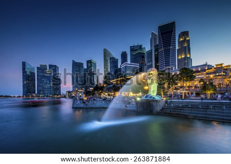 SINGAPORE - Jan 28: The Merlion fountain lit up at night on Jan 28, 2015 in Singapore. - stock photo