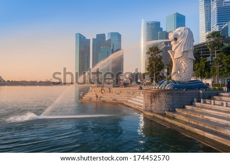 SINGAPORE-Jan, 18 - The Merlion fountain with sunrise on morning Jan 18, 2014 in Singapore. Merlion is a mythical creature with the head of a lion and the body of a fish,and is a symbol of Singapore. - stock photo