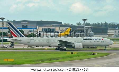 SINGAPORE - JANUARY 10: Air France Boeing 777-300ER taxiing at Changi Airport on January 10, 2015 in Singapore - stock photo