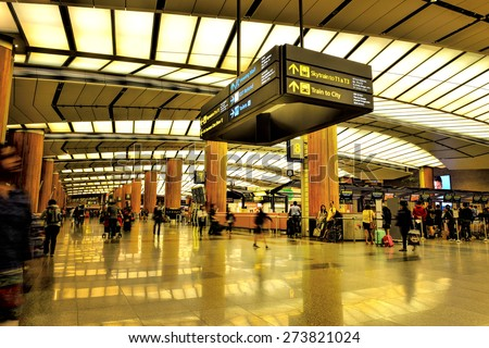 SINGAPORE - JANUARY 16: Changi International Airport on January 16, 2015 in Singapore. Singapore airport is the main aviation hub in Southeast Asia, handling 66 million passengers per year. - stock photo