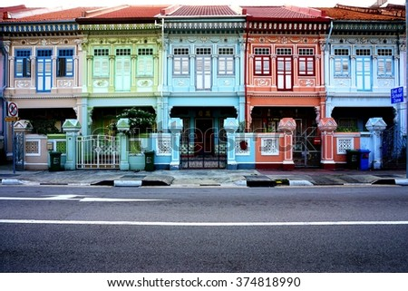SINGAPORE -24 JANUARY 2016- Colorful old pre-war Peranakan terrace houses on Koon Seng Road in Singapore. - stock photo