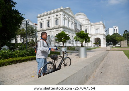 SINGAPORE - JANUARY 26, 2015: National Museum of Singapore is located in a historic building. Founded in 1848, the museum has grown from a personal collection and the library of Sir Stamford Raffles. - stock photo
