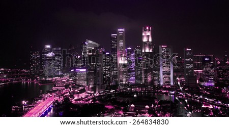 SINGAPORE - JANUARY 6: Panorama Singapore city at night. Skyline and modern skyscrapers of business district Marina Bay Sands at most financial developing Asian city state. Singapore, January 6, 2014. - stock photo