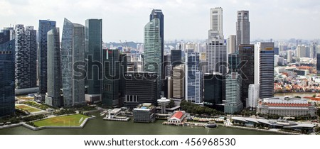 SINGAPORE - JANUARY 6,2014: Panorama Singapore city. Skyline and modern skyscrapers of business district Marina Bay Sands at most financial developing Asian city state. Singapore, January 6, 2014. - stock photo