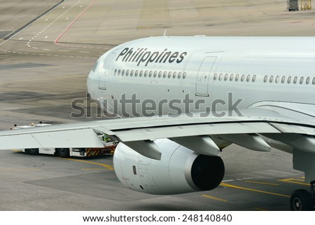 SINGAPORE - JANUARY 10: Philippines Airlines Airbus 330 ready for departure at Changi Airport on January 10, 2015 in Singapore - stock photo
