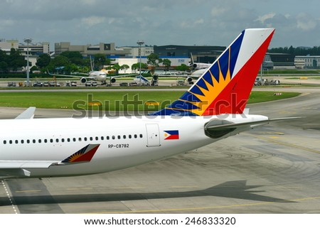 SINGAPORE - JANUARY 10: Philippines Airlines Airbus 330 taxiing to gate at Changi Airport on January 10, 2015 in Singapore - stock photo