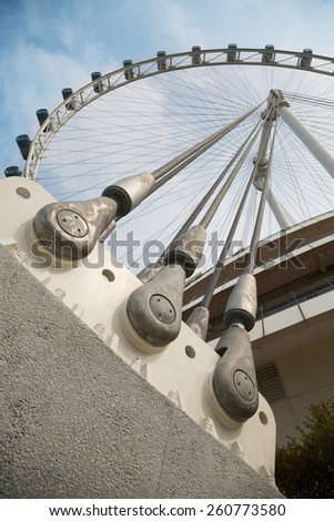 SINGAPORE - JANUARY 26, 2015: Singapore Flyer - a giant Ferris wheel, located in Singapore, built in 2005-2008. With a total height of 165 m, second tallest in the world. - stock photo