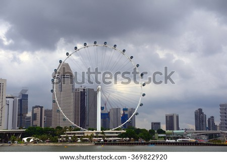 SINGAPORE - JANUARY 20 : Singapore Flyer on 20 January 2016 at Singapore. Singapore Flyer is one of the most popular attraction among tourists visiting the city state. - stock photo