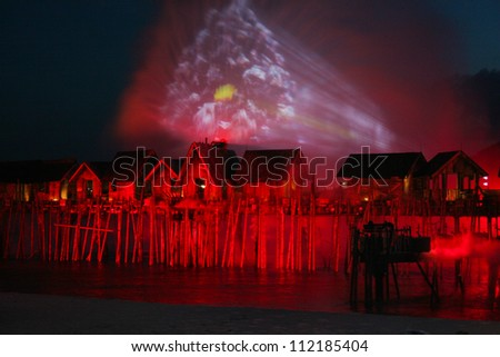 SINGAPORE - JANUARY 26:  Songs of the sea show on beach area of Sentosa Island in Singapore. Show using water, light and fire on January 26, 2010. - stock photo