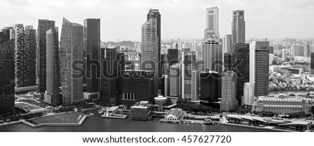 SINGAPORE - JANUARY 07, 2014: Urban landscape of Singapore. Skyline and modern skyscrapers of business district Marina Bay Sands at most financial developing Asian city state. Singapore. - stock photo