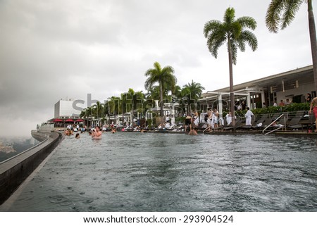 Singapore - January 7, 2015: View from the infinity pool at Marina Bay Sands during a thunderstorm.