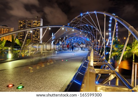 SINGAPORE - JANUARY 2: View of The Helix Bridge on January 2, 2011 in Singapore. The Helix Bridge is a  pedestrian bridge linking Marina Centre with Marina South in the Marina Bay area in Singapore. - stock photo
