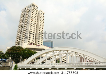 SINGAPORE - JUL 5, 2015. Elgin bridge, made in 1929, over the Singapore River in district Riverside. Bridges over the Singapore River are important in the city's infrastructure. - stock photo