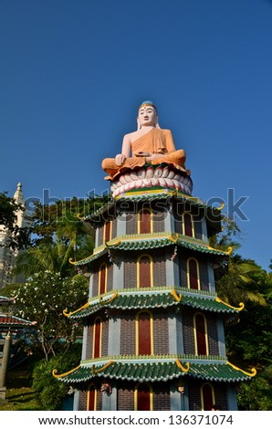 SINGAPORE - JUL 27: Statue of Buddha in the Haw Par Villa gardens on July 27, 2012 in Singapore. The park contains over 1,000 statues and 150 giant dioramas depicting  Chinese mythology and folklore,
