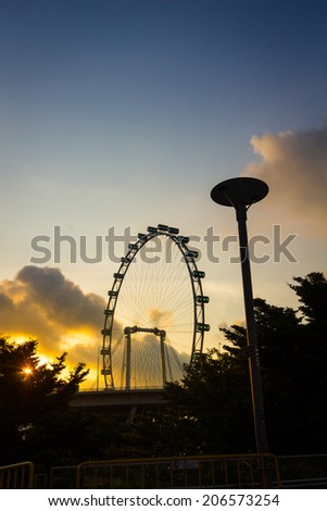 SINGAPORE - JULY 18: A silhouette view of Singapore Flyer,the largest observation wheel,on July 18, 2014.