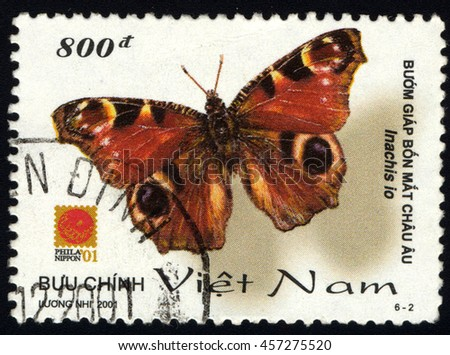 SINGAPORE JULY 24, 2016: A stamp printed in Viet Nam shows Inachis io (Butterfly), circa 2001