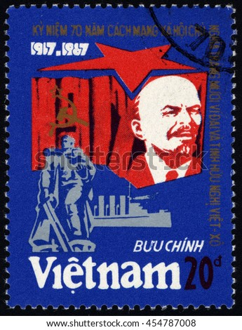 SINGAPORE â?? JULY 19, 2016: A stamp printed in Viet Nam shows Lenin with the October revolution, circa 1987