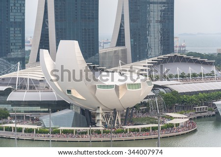 SINGAPORE - July 18, 2015: ArtScience Museum is one of the attractions at Marina Bay Sands, an integrated resort in Singapore. - stock photo
