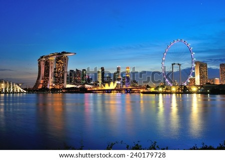 SINGAPORE - JULY 27: Beautiful evening skyline of Singapore business district area featuring Marina Bay Sands hotel and Singapore Flyer at Marina Bay July 27, 2013 in Singapore - stock photo