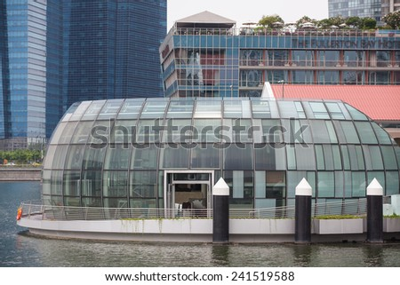 SINGAPORE - JULY 2012: Evening view of the Singapore River. The Singapore River Cruise is a tourist attraction in this former British colony. - stock photo