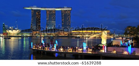 SINGAPORE - JULY 17: Fifty-five storeys high, US$ 6.3 biliion Marina Bay Sands Hotel dominates the skyline at Marina Bay July 17, 2010 in Singapore. - stock photo