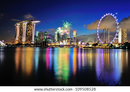 SINGAPORE - JULY 21: Fireworks display captured with Marina Bay city scape during National Day Parade 2012 Rehearsal on July 21, 2012 in Singapore - stock photo