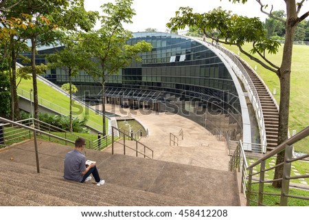 SINGAPORE - JULY 26, 2016_School of Art, Design & Media at Nanyang Technological University campus, Singapore. The place is a stunning piece of award-winning architecture situated in a wooded valley. - stock photo