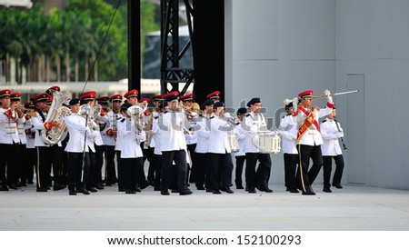 SINGAPORE - JULY 20: Singapore Armed Forces (SAF) band performing during National Day Parade (NDP) Rehearsal 2013 on July 20, 2013 in Singapore