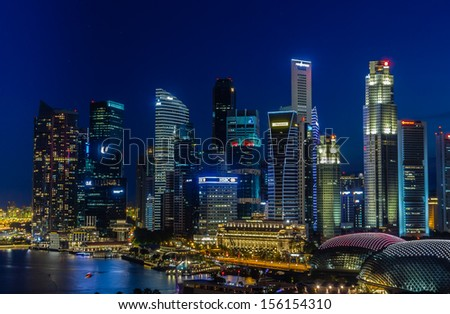 SINGAPORE - JULY 07 2013: The Marina Bay and waterfront area of the city of Singapore at dusk.