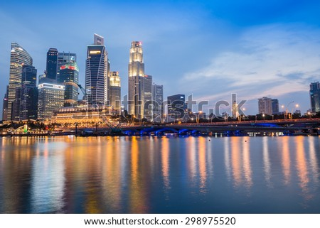 SINGAPORE-JULY 10 : The Singapore skyline in twilight time on July 10,2015. Singapore is the 14th largest exporter and the 15th largest importer in the world.      - stock photo