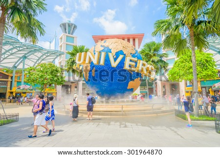 SINGAPORE - JULY 20: Tourists and theme park visitors taking pictures of the large rotating globe fountain in front of Universal Studios on JULY 20, 2015 in Sentosa island, Singapore - stock photo