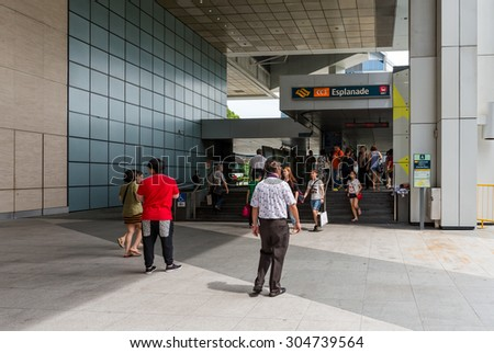 SINGAPORE-JULY10: Unidentified people at The Mass Rapid Transit (MRT) Esplanade on July 10, 2015 in Singapore. Singapore is a world famous tourist city with highly developed economic infrastructure. - stock photo