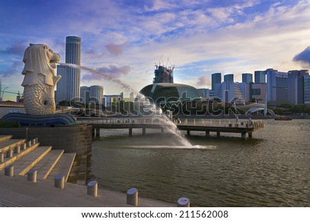 SINGAPORE - JULY 14: Wonderful landscape of Singapore, July 14, 2014, Singapore. The modern skyscrapers at business and financial district in morning time with the merlion, the symbol of Singapore. - stock photo