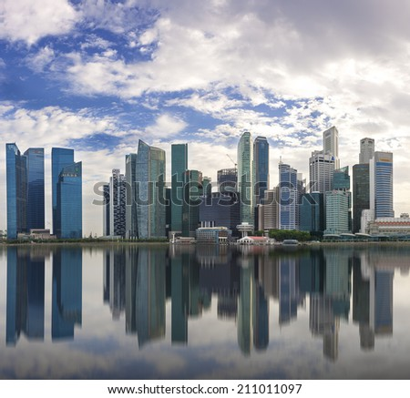 SINGAPORE - JULY 15: Wonderful reflection of waterfront skyscrapers, July 15, 2014, Singapore. The modern skyscapers at business and financial district of Marina Bay, Singapore.