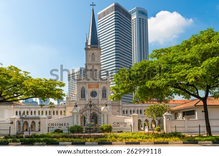 SINGAPORE - 02 JUN 2013: Entrance and old Chijmes church turret in neoclassical style with skyscrapers on background - stock photo