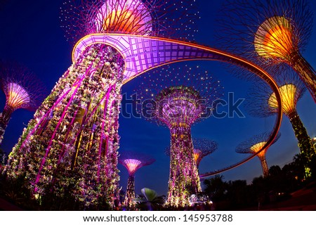 SINGAPORE-JUN 16: Night view of The Supertree Grove at Gardens by the Bay on June 06, 2013 in Singapore. Spanning 101 hectares, and five-minute walk from Bayfront MRT Station. - stock photo