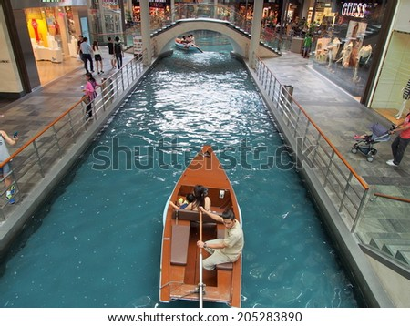 SINGAPORE - JUN 20: Small canal through the shopping mall at Marina Bay Sands Resort on June 20, 2014 in Singapore. It is Singapore' s first large-scale luxury shopping destination. - stock photo