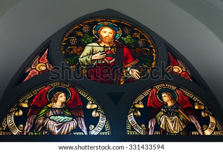SINGAPORE - 02 JUN 2013: Stained-glass window in Chijmes hall old church  in Singapore. - stock photo