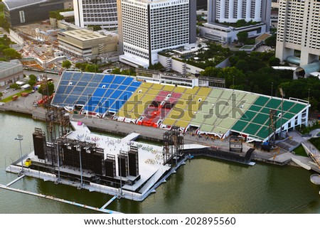 SINGAPORE-JUN 25: The Float at Marina Bay on June 25, 2014 in Singapore. It is also known as the Marina Bay Floating Platform and is the world's largest floating stage. - stock photo