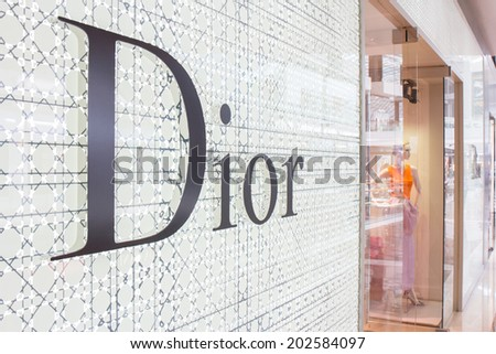 SINGAPORE - JUNE 19: Dior Store in Marina Bay Sands Shopping mall, Singapore on June 19, 2014. It is a French company controlled and chaired by Bernard Arnault who also heads Louis Vuitton.