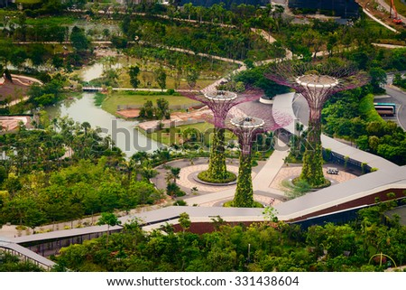SINGAPORE - 02 JUNE 2013: Gardens by the Bay a modern beautiful botanical garden with super trees. A major landmark and tourist attraction in the city. - stock photo