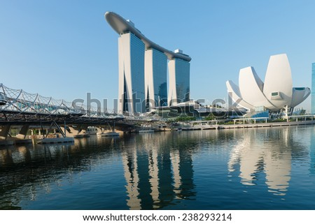 SINGAPORE - JUNE 01, 2013: Marina Bay Sands, an integrated resort and shopping mall with modern Helix bridge on front.  - stock photo