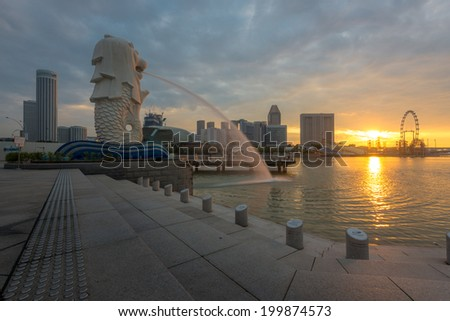 SINGAPORE - JUNE 14 : Merlion statue in the morning of June 14, 2014 with Singapore Flyer in the background