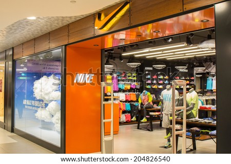 SINGAPORE - JUNE 20: Nike store in Changi Airport, Singapore on June 20, 2014. It is an American company, engaged in the design and manufacturing of footwear, apparel, equipment and services. - stock photo