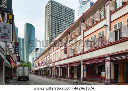SINGAPORE - JUNE 22, 2016 : old style shop house in Bugis, Singapore narrow to high rise building in background