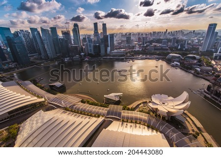 SINGAPORE - JUNE 25 : Singapore Skyline and Marina bay from the Sand Sky Park on June 25, 2014. Marina Bay is a bay near Central Area in the southern part of Singapore. - stock photo