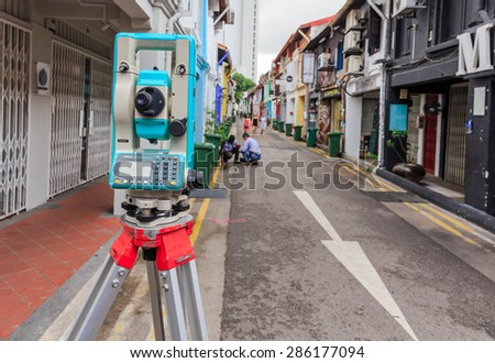 SINGAPORE -JUNE,10: The equipment of civil engineer for survey and measure level of the road that fixed at old town of the city. SINGAPORE JUNE,10 2015  - stock photo