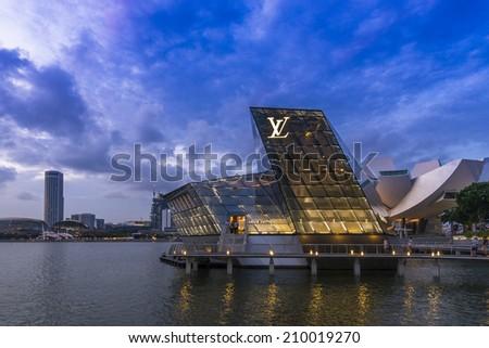 SINGAPORE - JUNE 26: The futuristic building of Louis Vuitton shop in Marina Bay, Singapore on June 26, 2014. - stock photo