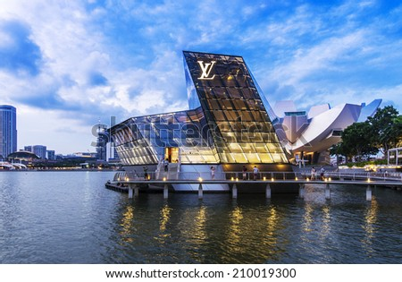 SINGAPORE - JUNE 26: The futuristic building of Louis Vuitton shop in Marina Bay, Singapore on June 26, 2014. - stock photo